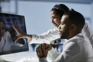 Researchers analyzing data